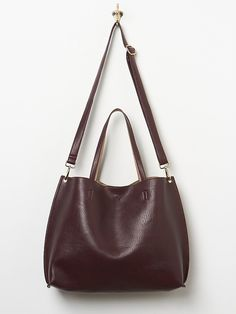 Free People Slouchy Vegan Tote - Just picked this up in the whiskey/blue.  Reversible, shoulder bag or cross body, comes with a large clutch and wristlet!