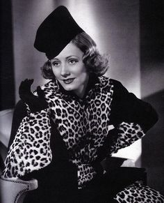 """In """"Joy of Living"""" (1938) Irene Dunne wears a leopard accented outfit that projects a witty, slightly wicked demeanor. Costumes by Robert Kalloch and Edward Stevenson."""