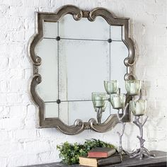 Prisca - This mirror frame features a distressed silver leaf finish with black undertones. The etched, antiqued mirror has four matching rosettes.     Designer: Grace Feyock   Dimensions:  W: 165cm x H: 165cm x D: 5cm      Weight:  64kg