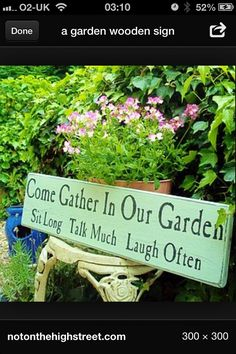 Garden sign: Come gather in our Garden. Sit Long Talk Much Laugh Often