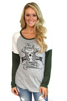 Get in the holiday spirit with this super cute long sleeve Christmas tee! True to size, but more fitted. For extra room go up a size. Material: 95% Rayon 5% spandex Model is 5'5'' a size 0 wearing a s