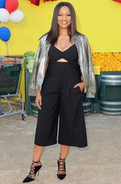 Garcelle Beauvais in a black cutout culotte jumpsuit and silver jacket