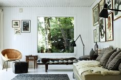 In the beadboard-paneled living room of her summer house in Copenhagen, Danish designer Charlotte Vadum uses daybeds—placed at right angles ...