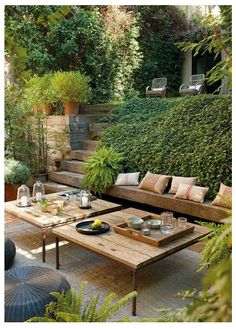 rustic wood beam tables and walls + tons of ferns and ivy built into a hill