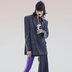 #80s No-nonsense power suit and disco ready second-skin sock boots give the 80s trend a fresh come-back this spring.@Angelica_Cheung #回归80 宽大垫肩的西服套装搭配紫色长靴严肃与个性并存 Photographer: 许闯 Trunk Xu (@trunkxu) Stylist: 姚雨杭 Yuhang Yao (@yuhang_yao)  via VOGUE CHINA MAGAZINE OFFICIAL INSTAGRAM - Fashion Campaigns  Haute Couture  Advertising  Editorial Photography  Magazine Cover Designs  Supermodels  Runway Models