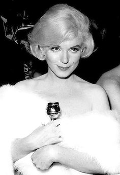 Marilyn Monroe with her Best Actress in a Comedy golden globe for Some Like It Hot, 1960.