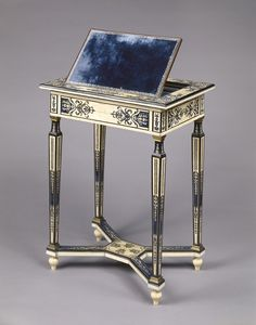 """This reading and writing table once resided in the Palace of Versailles. It now lives gallery S108 (in the South Building) at the Getty Center. -- Reading and Writing Table, about 1670-1675, Unknown. Oak veneered with ivory, blue painted horn, ebony; rosewood, and amaranth  with drawer of walnut; gilt-bronze moldings; modern velvet. J. Paul Getty Museum."""