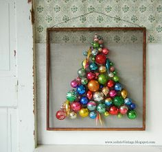 DIY:  Vintage Ornament Christmas Tree - easy tutorial showing how to attach ornaments to a salvaged screen. You don't need a lot of ornaments to make this and they don't have to be glued to the screen - via So Into Vintage