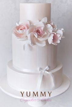 Lovely Multi-Layer White Wedding Cake.with Pink and White Flowers & Bow...Quite Elegant ❣