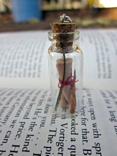 magic bottle necklace -- wand, scroll, and phoenix feather