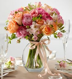 A lovely pink and peach floral arrangement.