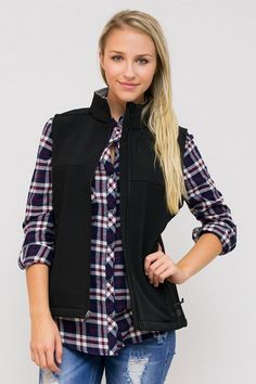 Soft shell vest with a zip up front and two zip up pockets. Perfect for layering. Fleece lined interior for added warmth. Wind and water resistant. Designed with a special middle laminate layer for th