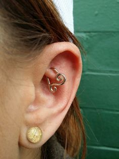 Healed rook piercing I performed featuring a 14 kt white gold archimedes heart from Leroi fine body jewelry.