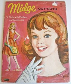 Passed down from my mom, I played with the 1962 Midge paper doll set.  In case you didn't know, Midge was Barbie's best friend!