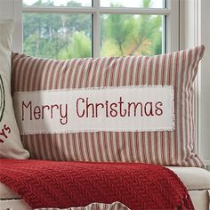 """This decorative pillow featuring the words """"Merry Christmas"""" - Cotton with poly fill insert, zipper closure - Size: 16""""x26"""" - Machine wash gentle, hang dry"""