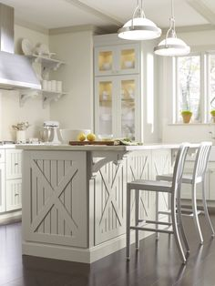 Beautiful millwork details from Martha Stewart's horse stable at Bedford inspired the Seal Harbor kitchen design, featuring an updated country aesthetic. Available exclusively from Martha Stewart Living™ at The Home Depot.