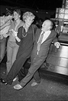 Truman Capote with a friend at Studio 54 in 1977 by Allan Tannenbaum