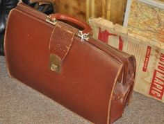 70s leather briefcase - http://whatkatydid.biz/product/accessories/70s-leather-briefcase/