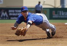 New York Mets third baseman David Wright makes a diving catch in the second inning of his first spring training game