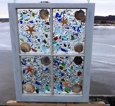 19 x 25 Great privacy window for a bathroom or kitchen. Lots and lots of beach glass in shades of blues, greens even a touch of yellow and pinks. Accented with natural sugar star fish and native scallop shells. This is truly for the beach lover.... Slightly higher shipping cost to CA and HI Message for rates please