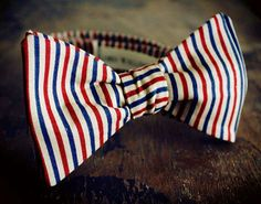 Multi Color Beige Red And Blue Stripped Bow Tie by Lord Wallington