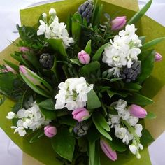 A lovely bouquet of sweet smelling White Stocks, Pink Tulips and Hyacinths with complimentary foliages. Red Rose optional extra.