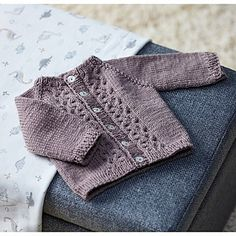 Sweet little cables accent the front of this seamless, top-down raglan. The Frida Baby Cardigan knit in Valley Superwash DK, is an adorable cardigan that will not only be soft and warm, but machine-washable too. Perfect for baby!