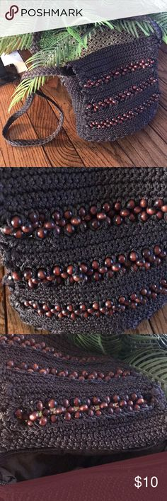 Chocolate Brown Macrame Purse With Wood Beads Cross body macrame purse with flap top with wooden beads woven in and zipper to compartment with brown cotton lining.  Excellent condition. Strap is 42 inches.  7-1/2 inches wide and 8 inches high. Bags Crossbody Bags
