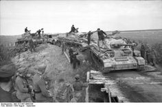 Three Panzer IV make a river crossing on an improvised bridge, August-September 1943.