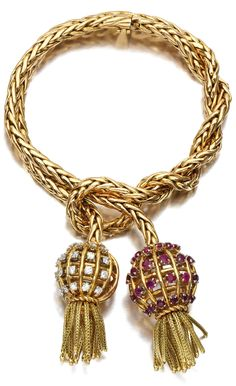 Retro gold, ruby, and diamond tassel bracelet by Sterlé, circa 1950.