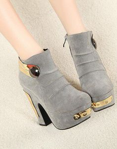 futuristic looking suede boots with metal detailing. I'm not crazy about the gold metal, but i do like the style