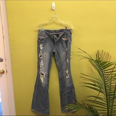 Distressed bell bottom jeans Says size 9 but would fit a 26-27 nicely. Like brand new, lightly worn. feel free to ask me any questions! I'm always open to offers and trades :) (brand for views) Levi's Jeans Boot Cut