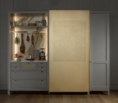 From brunch to aperitifs - a sliding mesh panel used on our hand-painted floating cabinet