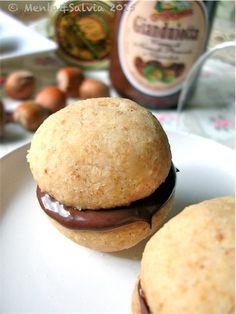 Little cookies with chocolate and hazelnut cream. The taste of italian food.