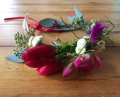 flower crown made with red tulips, freesia, chamomile and eucalyptus