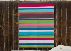 This strip quilt pattern is so pretty! We love the almost rainbow quilt look.