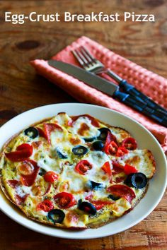 Egg-Crust Breakfast Pizza with Pepperoni, Olives, Mozzarella, and Tomatoes is a delicious low-carb breakfast option that's almost as good as cold pizza for breakfast! [from Kalyn's Kitchen] #LowCarb #SouthBeachDiet #GlutenFree #HealthyNewYear