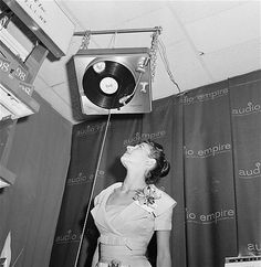 Image: Upside down phonograph (© Ruben Goldberg/AP) A visitor to the New York High Fidelity Show in 1960 marvels at a turntable that can play on the ceiling, a device that failed to turn the world upside down.