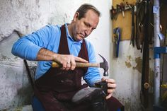 Shoemaker repairing a shoe in his  workshop