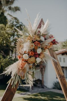 Earthy Autumnal Wedding at Casa Cody in Palm Springs | Junebug Weddings - earthy and rust-colored flowers, wedding backdrop with dried flowers and pampas grass. Geometrical backdrop for ceremony. Wedding arch wood Boho Wedding Flowers, Outdoor Wedding Decorations, Rustic Flowers, Flower Decorations, Floral Wedding, Dried Flower Arrangements, Wedding Flower Arrangements, Fall Wedding Arches, Wedding Arch Rustic
