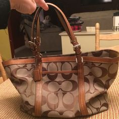 """Authentic signature Coach bag Great condition. 13"""" width, just under 12"""" in length. Has stain mark in last pic, which is on front of bag. Has slight wear on bottom corners of bag. Smoke free home. At this point, the dust bag is misplaced, if found by time bag sells, it will go along...sorry. Coach Bags"""