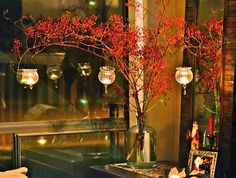 rose hip branches and hanging glass tea light holders http://www.save-on-crafts.com/hangingcandle.html