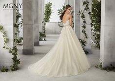 A strapless lace embroidered bodice with a moonstone waistband meets a sparkle tulle ball gown