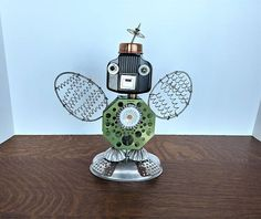 Found object robot insect. Assemblage Art - Sol the shutterbug is equipped for everything. He wears his light meter on his chest, and has wings to get those all important aerial shots. Stealthy! Yes, he can be a bit annoying, but he never uses a flash, so that's a plus.