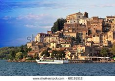 Sold! Stock photo available for sale at Shutterstock: Travel Series - Anguillara Sabazia on Bracciano lake, Lazio, Italy. - stock photo