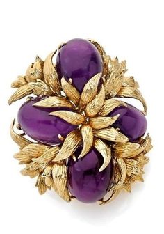 David Webb ~ Yellow gold and white gold brooch, decorated with four cabochon amethysts. David Webb, Shades Of Purple, Purple Gold, White Gold, Purple Jewelry, Amethyst Jewelry, Corsage, Or Violet, Jacqueline Kennedy Onassis