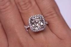 5 carat, J, VS2 cushion cut engagement ring with a setting done by Leon Mege
