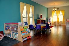 I really like the way this room is set up. Good example of a home daycare/preschool.