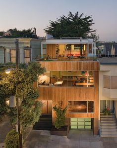 Modern home with a fabulous rooftop deck by Craig Steely Architecture