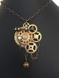 A personal favorite from my Etsy shop https://www.etsy.com/listing/273542128/steampunk-clock-gear-necklace-soldered